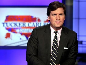 "In this file photo, Tucker Carlson, host of ""Tucker Carlson Tonight,"" poses for photos in a Fox News Channel studio, in New York"
