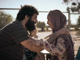 "Fayssal Bazzi and Soraya Heidari as Afghan refugees in Netflix's Australian drama ""Stateless."""