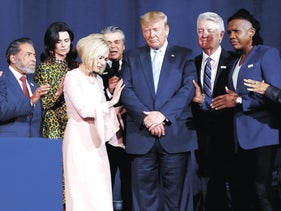 President Donald Trump participating in a prayer before speaking at an Evangelicals for Trump Coalition Launch in Miami, Florida, January 3, 2020.