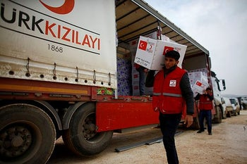Turkish Red Crescent workers carrying humanitarian in Idlib province, Syria, January 17, 2018.