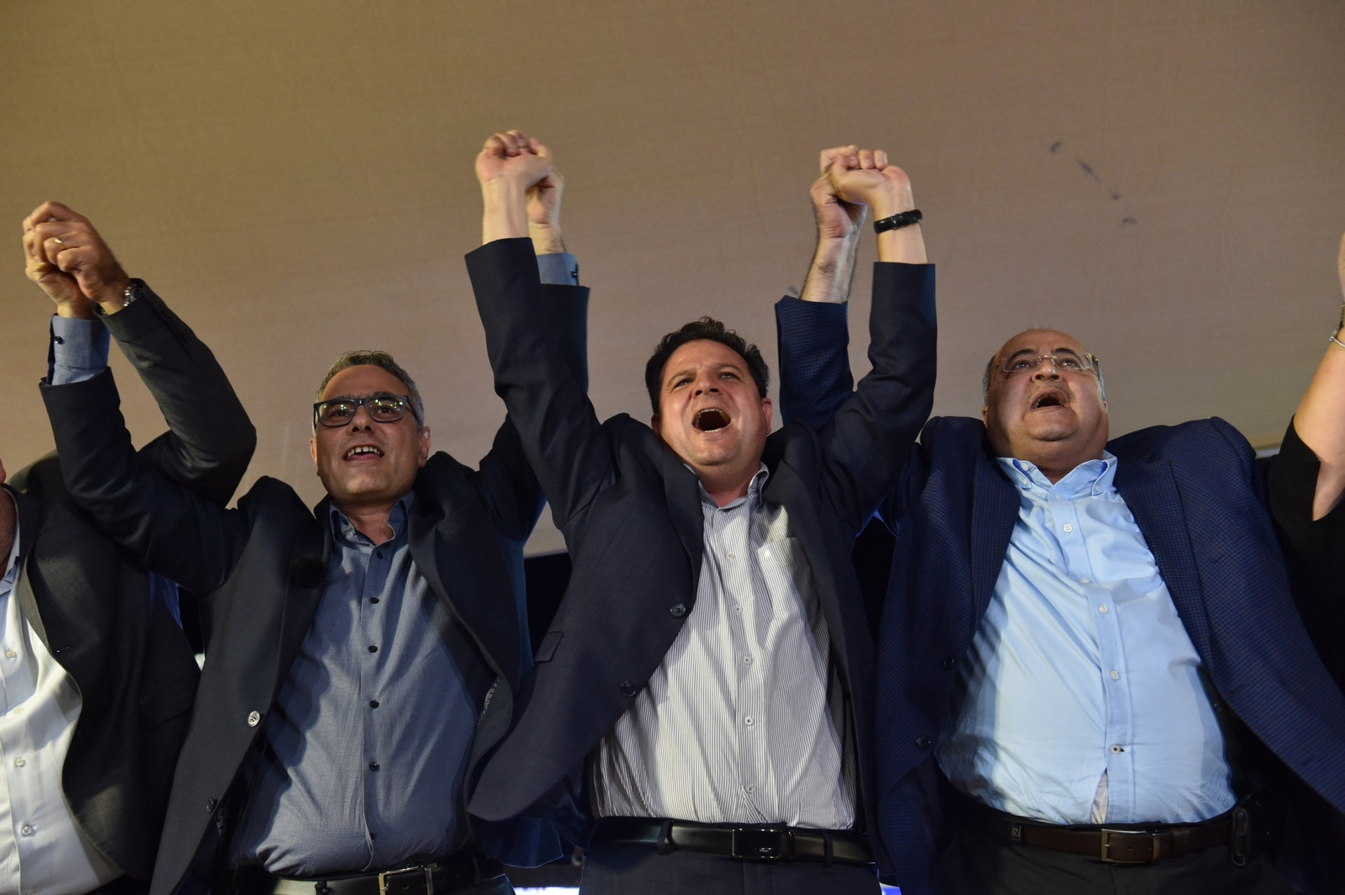 Joint List MKs Ahmad Tibi, right, and Ayman Odeh, center, after hearing the initial election results, Sept. 17, 201