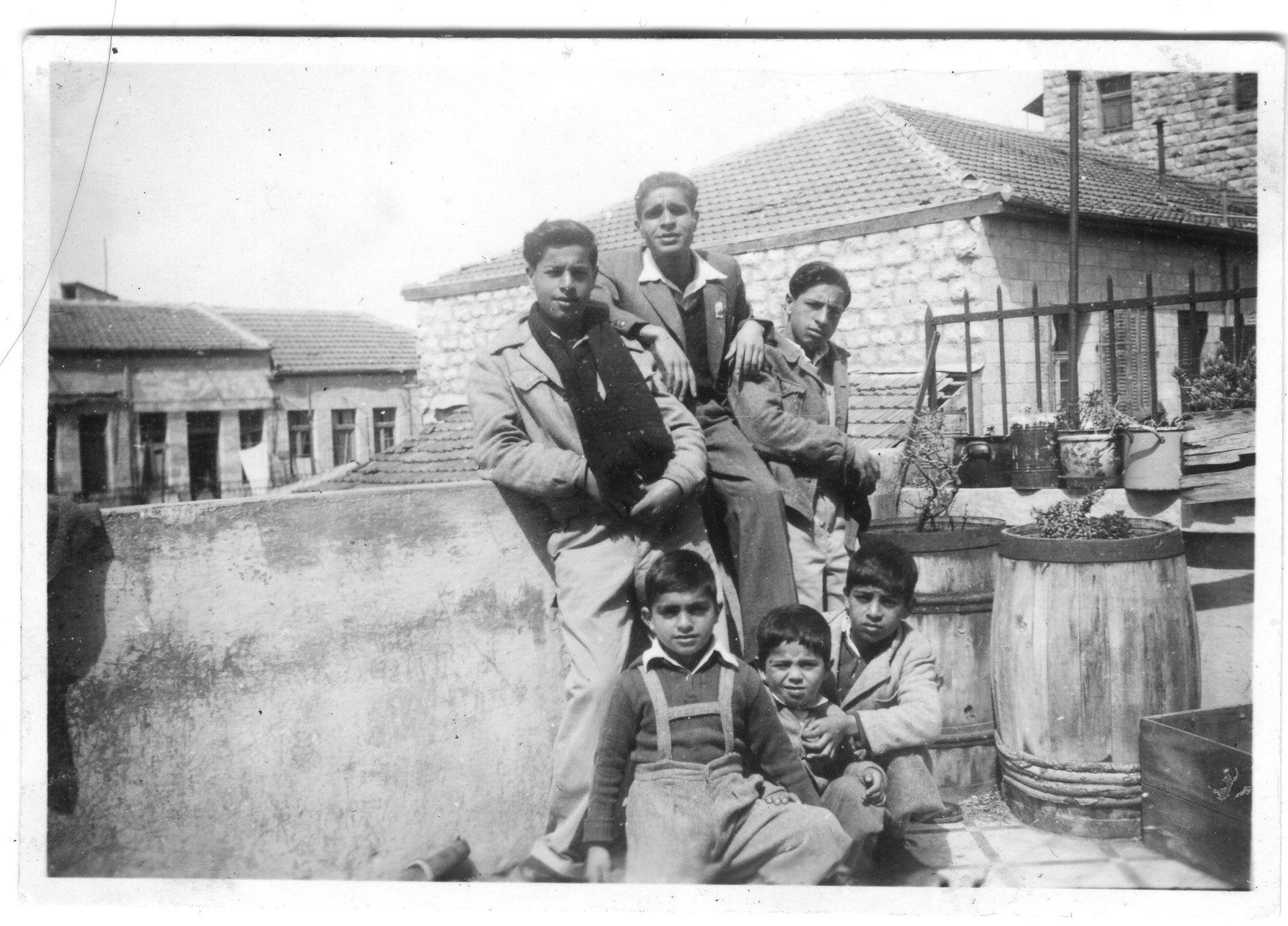 """Members of the Banai family, on Ha'agas Street in Jerusalem. The photo is featured in the """"Banai – A Musical Journey from Persia to Jerusalem"""" exhibition on at the Tower of David Museum, July 2020"""