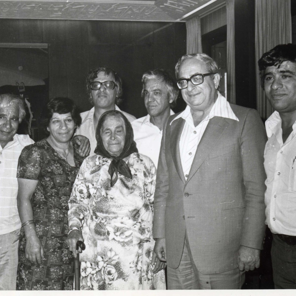 """Members of the Banai family with Israel's President Yitzhak Navon, second from right. This is one of the photos on display at the Tower of David exhibition """"Banai – A Musical Journey from Persia to Jerusalem,"""" in Jerusalem, July 2020"""