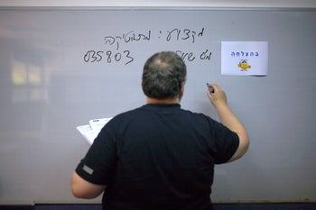 A teacher writes on the board during a maths exam at a school in central Israel. Illustration