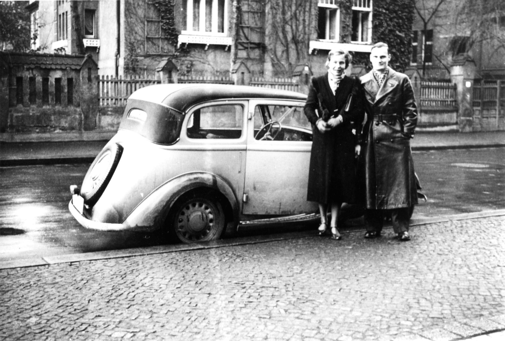 """Harro and Libertas with """"Caesar,"""" their light blue 24 horsepower Fiat convertible. They drove the car to Italy in the fall of 1938, arriving back in Berlin just before Kristallnacht began."""