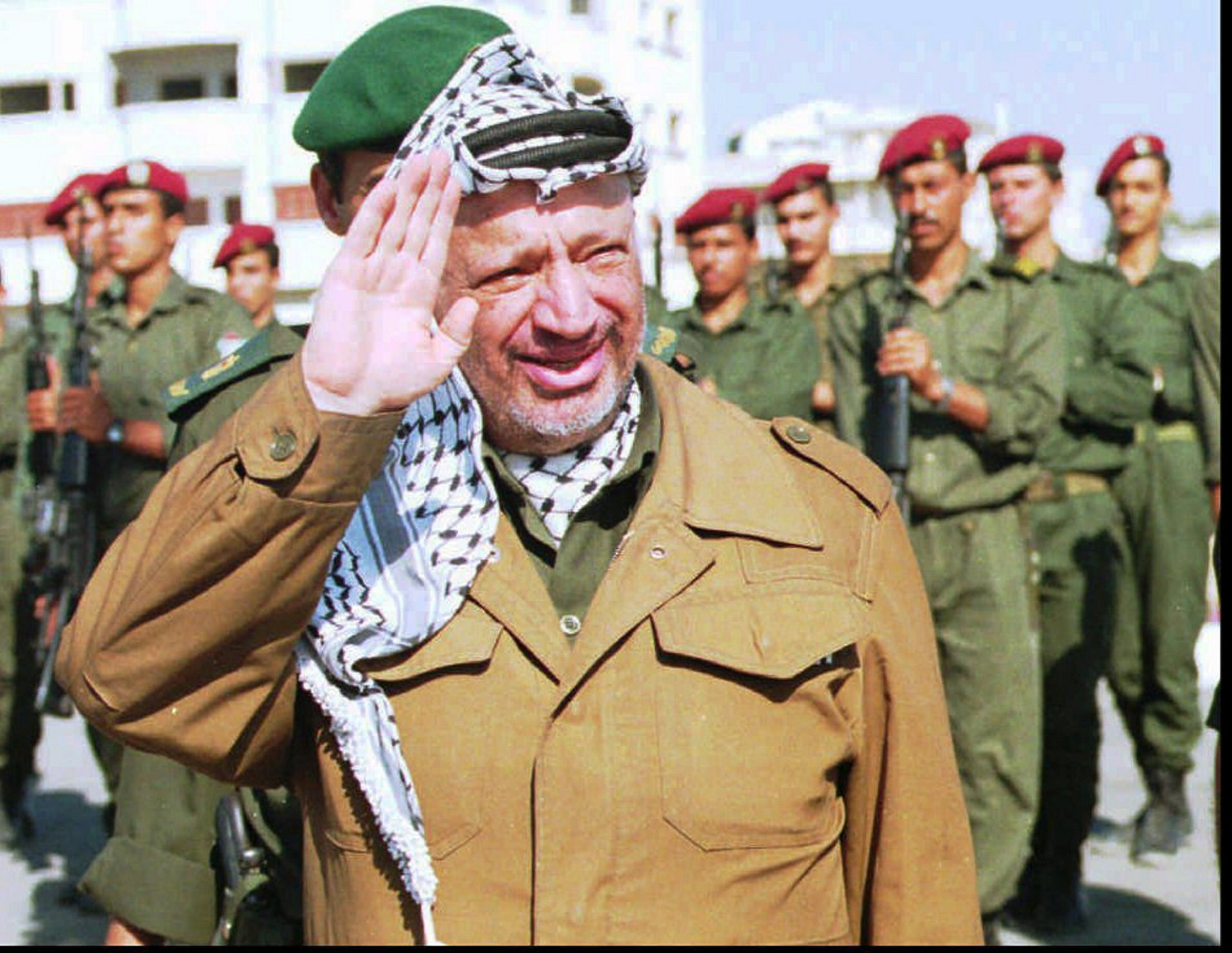 PLO leader Yasser Arafat waving to well-wishers as he returns from Cairo to his office in Gaza City, June 1995.