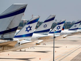 The tail ends of Israeli El Al airline aircraft are seen on the tarmac at Israel's Ben Gurion Airport in Lod, east of Tel Aviv, on July 7, 2020.