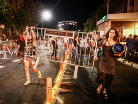 Protesters take down barriers at the end of a protest calling for Benjamin Netanyahu's resignation in Jerusalem, July 14, 2020.