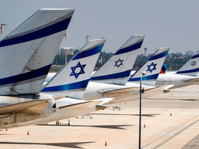 The tail ends of Israeli El Al airline aircraft are seen on the tarmac at Israel's Ben Gurion Airport on July 7, 2020.