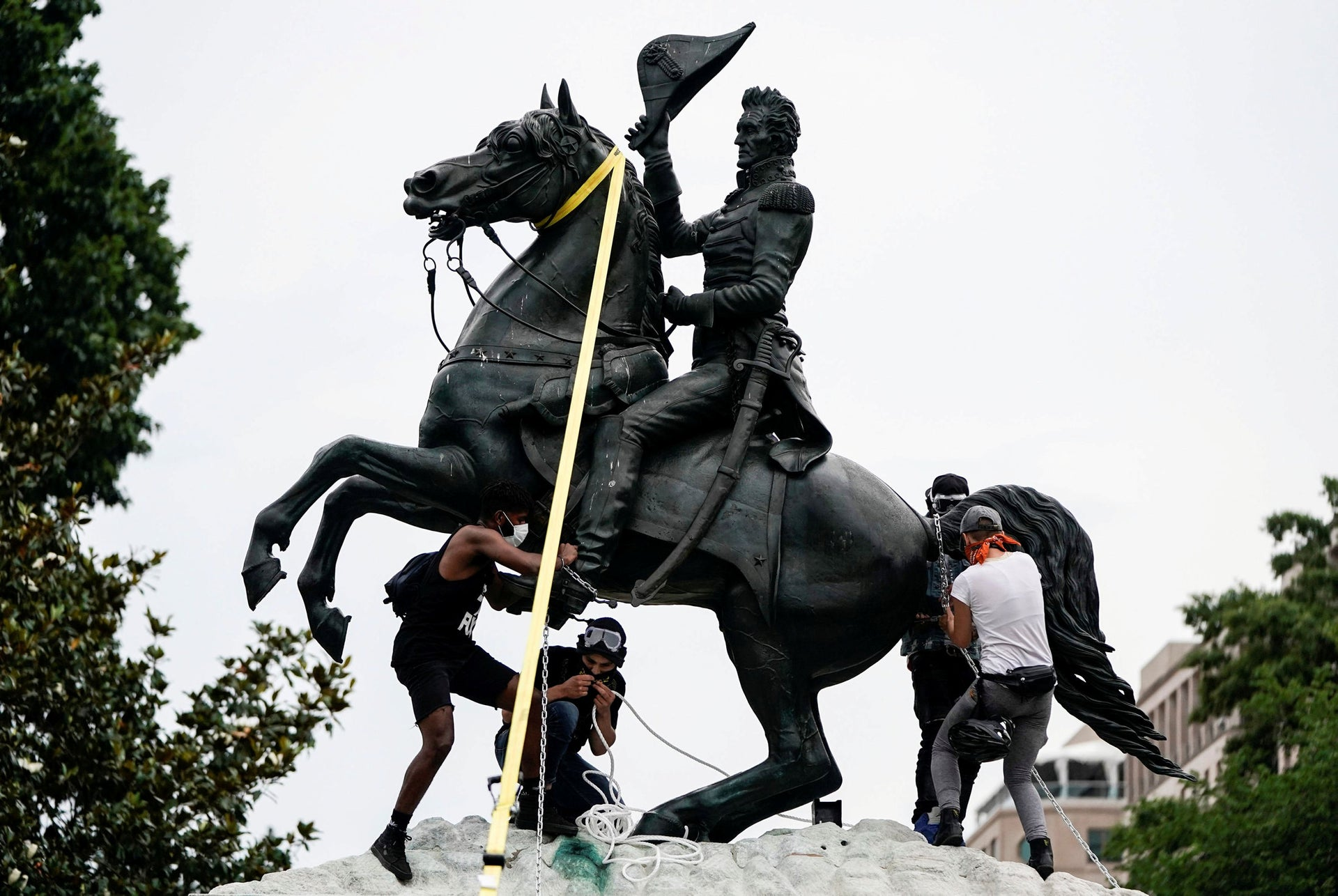 Protestors try to pull down the statue of U.S. President Andrew Jackson at Lafayette Park in front of the White House during racial inequality protests in Washington, D.C., June 22, 2020.