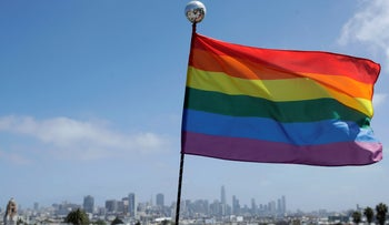 File photo: A rainbow flag flies over the skyline at Dolores Park in San Francisco, June 28, 2020.