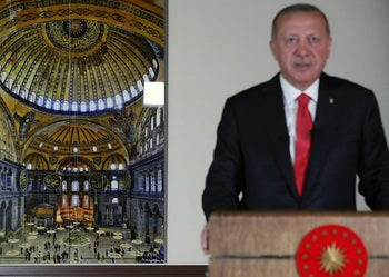 Turkey's President Recep Tayyip Erdogan, backdropped by a photograph of Hagia Sophia, delivers a televised address to the nation, in Ankara, Turkey, July 10, 2020.