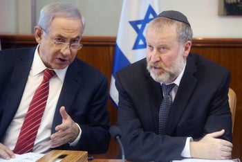 Netanyahu and Mendelblit during a weekly government meeting in Jerusalem, 2015