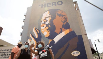 Mourners view a makeshift memorial to the passing of the late Rep. John Lewis under his mural in Atlanta, Georgia, U.S. July 18, 2020.
