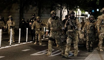 Federal officers prepare to disperse the crowd of protestors outside the Multnomah County Justice Center on July 17, 2020 in Portland, Oregon