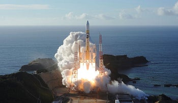 """In this handout photograph taken and released on July 20, 2020 by Mitsubishi Heavy Industries an H-2A rocket carrying the Hope Probe known as """"Al-Amal"""" in Arabic, developed by the Mohammed Bin Rashid Space Centre (MBRSC) in the United Arab Emirates (UAE) to explore Mars, blasts off from Tanegashima Space Centre in southwestern Japan"""