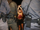 A young demonstrator standing in front a line of Israeli police officers during a protest against Prime Minister Benjamin Netanyahu in Jerusalem, July 18, 2020.