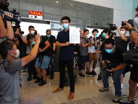 Hong Kong pro-democracy activist Joshua Wong poses for a picture with the nomination papers as he files his candidacy in Legislative Council elections due in September in Hong Kong, July 20, 2020.