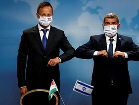 Hungarian Foreign Minister Peter Szijjarto, left, and his Israeli counterpart, Gabi Ashkenazi, in Jerusalem, July 20, 2020.