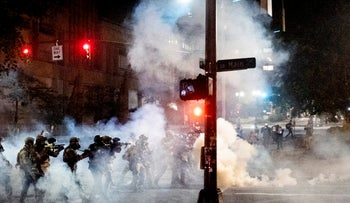 Federal agents use crowd control munitions to disperse Black Lives Matter protesters near the Mark O. Hatfield United States Courthouse on Monday, July 20, 2020, in Portland, Ore. Officers used teargas and projectiles