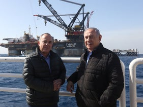 Prime Minister Benjamin Netanyahu (R) and Energy Minister Yuval Steinitz  during the inauguration of the foundation platform for the Leviathan natural gas field, on January 31, 2019.
