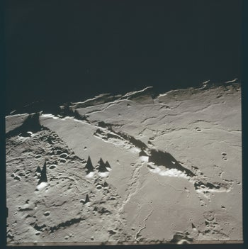 Mountain ridges rising above the regolith on the moon