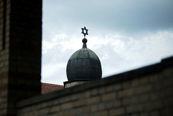 A star of David stands at the top of the synagogue in Halle, Germany, Monday, July 20, 2020.