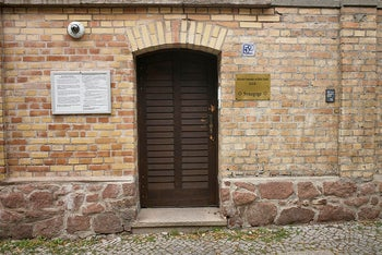 Bullet holes are still visible in the wooden door of the synagogue in Halle, Germany, July 20, 2020.