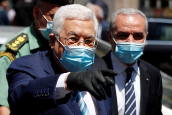 Palestinian President Mahmoud Abbas with Prime Minister Mohammad Shtayyeh in Ramallah, the West Bank, June 15, 2020.