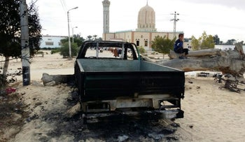 File photo: A burned-out truck outside a mosque in Bir al-Abed in northern Sinai, Egypt, a day after attackers killed hundreds of worshipers, November 25, 2017.
