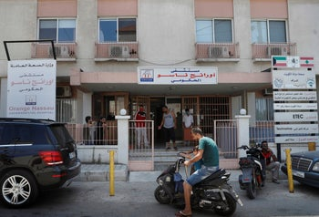 People gather at the entrance of the Orange Nassau Governmental Hospital, in Tripoli, Lebanon, July 16, 2020.