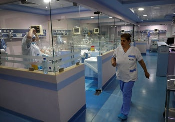 Nurses work at the neonatal intensive care unit, at Family Medical Center, a private hospital facing financial difficulties, in Majdalaiya village, north Lebanon, July 16, 2020.