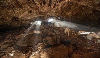 Team members entering the Chiquihuite cave in Mexico.