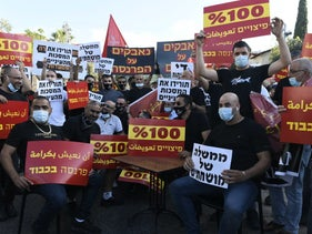 Restaurant owners and workers demonstrate against the Israeli government's coronavirus response, Haifa, July 21, 2020.