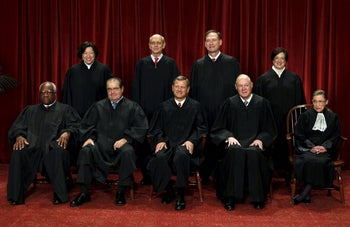 Justice Ruth Bader Ginsburg posing for a Supreme Court photo in 2010.