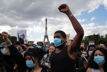 Hundreds of demonstrators gather on the Champs de Mars during a demonstration in Paris, France, June 6, 2020, to protest against the recent killing of George Floyd.
