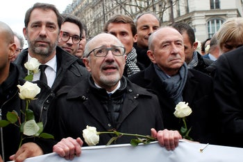 CRIF President Francis Kalifat, center, with lawmakers Gerard Collomb and Christophe Castaner, march in memory of Mireille Knoll, a woman killed in an anti-Semitic attack in Paris, March 2018.