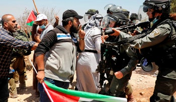 Palestinian demonstrators are confronted by Israeli forces during a protest in the town of Assira al-Shamaliya, the West Bank, July 17, 2020.