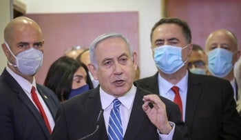 Prime Minister Benjamin Netanyahu accompanied by members of his Likud Party in masks delivers a statement before entering the district court in Jerusalem, May 24, 2020.