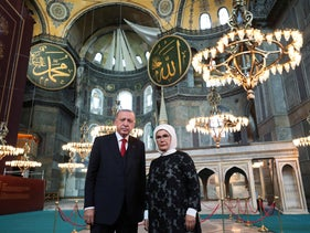 Erdogan, accompanied by his wife Emine, poses for photographs as he visits the Byzantine-era Hagia Sophia, in the historic Sultanahmet district of Istanbul, July 2020.
