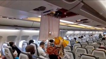 An image from the state-run Iran Press news showing released oxygen mask in the cabin of an Iranian passenger plane after it was intercepted by a US F-15 while flying over Syria, on July 24, 2020.