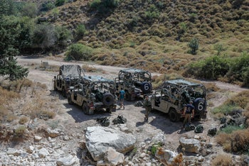 Israeli soldiers by their vehicles near the northern town of Rihaniya, near the border with Lebanon, July 24, 2020