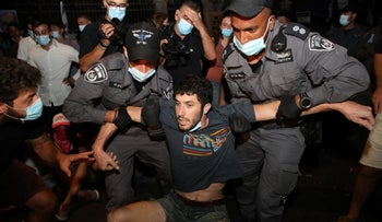 Police drag a protester from off the ground, Jerusalem, July 25, 2020