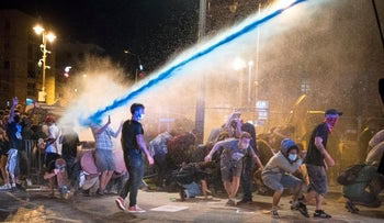 Anti-Netanyahu protesters demonstrating in Jerusalem as police use water cannons to disperse them, July 23, 2020.