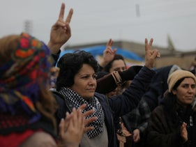 A woman gestures during a protest near the Syrian-Turkish border in Ras al-Ayn town, Syria December 20, 2018.