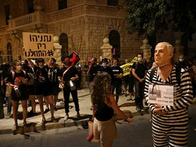 Protesters calling for Netanyahu's resignation demonstrate near his official residence, Jerusalem, July 25, 2020.