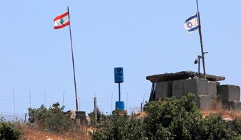 A picture taken on July 12, 2020 near the northern Israeli town of Shtula shows the demarcation line drawn by the UN to mark Israel's withdrawal from southern Lebanon in 2000.