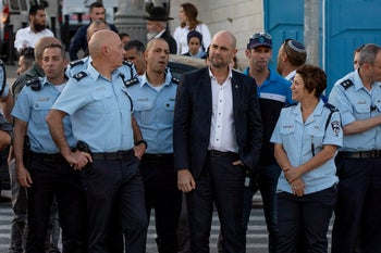 Public Security Minister Amir Ohana surrounded by police officials in Jerusalem, May 2020.