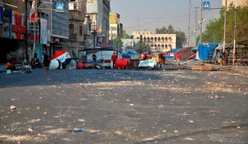 Anti-government protesters gather by barriers near Tahrir square, Baghdad, Iraq, July, 27, 2020.