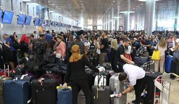 People waiting in the Departures hall at Ben Gurion Airport in pre-coronavirus times.